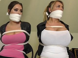 Busties trapped in quarters BDSM enslavement tied nearby